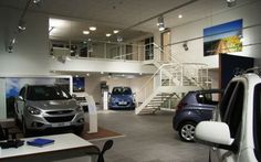 Our team spray painted the stairs within this car showroom to give the inside a new lease of life! The result is fantastic! http://www.vandacoatings.co.uk/ #paint #spraypaint #carshowroom