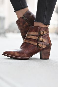 Two tone leather short boot by BEDSTU. An ankle bootie with a wearable heel and fashionable buckle accents. Pair with skinny denim to show it off.