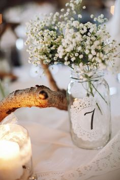 baby's breath and doily. since there are so few of us this would be nice for table place cards.