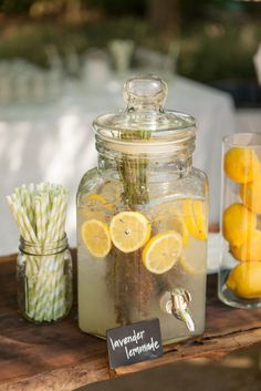 accessorize lemonade bar with fresh lemons in pillar candle holders or hurricane glasses, circus straws in mason jars and chalkboards for labeling