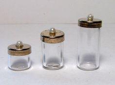 Miniature glass canisters w/metal lids