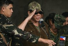 Philippine President Rodrigo Duterte's warning came just a month after foreign and local IS supporters ravaged Mindanao's main Muslim city of Marawi China Train, Rodrigo Duterte, Mindanao, Greatest Presidents, Troops, Muslim, Philippines, Southern, United States