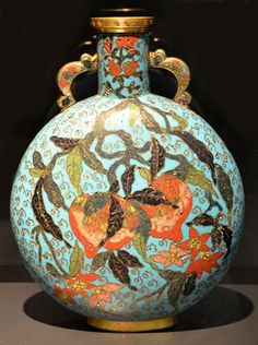 PIlgrim flask decorated with peaches and pomegrenates; Ming Dynasty, 1st half of 17th century