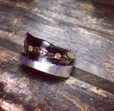 19kt white gold, diamond, and oxidized Sterling silver engagement band. Handcrafted and one of a kind.