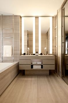 45 Stylish And Cozy Wooden Bathroom Designs | DigsDigs | I like the lights next to the mirrors.
