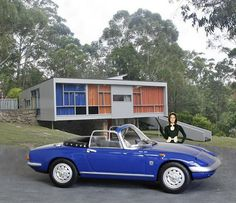 Mrs Emma Peel's Blue Lotus Elan outside Mid Century Modern House