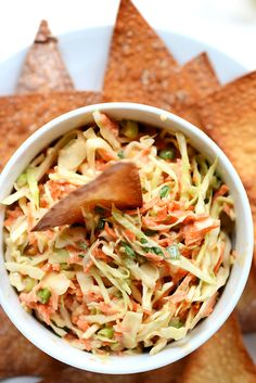 Creamy thai slaw made with simple, fresh ingredients and baked wonton chips. A super light and healthy Thai appetizer or snack! Baker Recipes, Raw Food Recipes, Asian Recipes, Healthy Recipes, Ethnic Recipes, Asian Foods, Vegetable Recipes, Keto Recipes, Healthy Snacks
