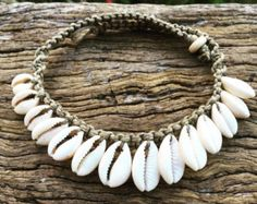 Hemp Macrame Necklace with Cowrie Shells, Bohemian Gypsy This is a hemp twine necklace with beautiful Cowrie shells, woven using the knot stitch. This necklace clasps easily around the neck using a strong wooden bead through the knot technique. It reacts well to water, and can be worn on the beach and in the ocean, however we do recommend removing any jewellery before swimming in the surf. Specs: •Cowrie Shells •Polished Hungarian Hemp Cord, 1mm •Necklace length is 15 inches (39cm) **If you…