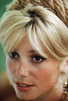 24femmespersecond:  Catherine Deneuve hasfreckles  Catherine Deneuve: the twenty-one year old star of Les Parapluies de Cherbourg (a.k.a. The Umbrellas of Cherbourg 1964).