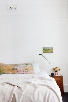 Minimalistic bedroom with tiny artwork