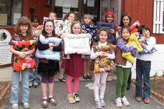 Photo by KATE O'SHEA Brownie Troop 10647 donated more than 45 handmade pet beds to the Humane Society for Greater Nashua as part of its It's Your World – Change It Brownie Quest recently.