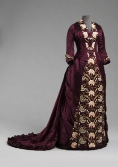 • Woman's Dress. Made in United States Date: ca. 1876 Medium: Aubergine silk satin with green, peach, brown, and white silk and silk chenille machine embroidery in satin and basket stitches, peach glass beads, metal beads. Source: philamuseum.org