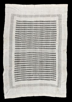 AS469 - All white hand spun cotton woman's shawl dating from the nineteenth century. This is the most complex of the small number of white shawls of this type that we have been able to collect, with three registers of design: a central field of long openwork holes broken up by a central panel of smaller holes; a frame around the central block made up of smaller holes; and finally rows of even smaller holes along the two ends of the cloth and triangular patterns made by using thicker threads i...