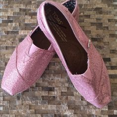 NWOT Glitter Pink Toms Classics NWOT Glitter Pink Toms Classics casual slide...TOMS toe-stitch...elastic V for easy on and off...TOMS classic suede insole with cushion for comfort...latex arch insert for added support...one-piece mixed-rubber outsole for resilience, flexibility and durability...box not included Retail $59 TOMS Shoes Flats & Loafers