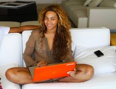 Beyonce looking flawless with her neon orange SmartShell for MacBook by her side