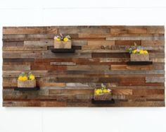 Wood wall art with floating wood shelves made of by CarpenterCraig