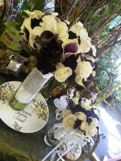 Picasso calla lilies eggplant calles white roses plum moonstruck carnation wrapped with satin and rhinestones and bridal bouquet