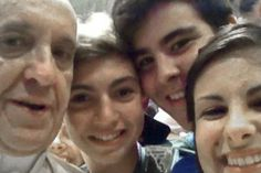 A photo was snapped of Pope Francis posing with a group of Italian teenagers and posted on social media