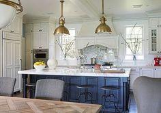 White cabinets, dark lower island, marble everywhere.