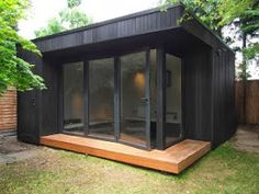 Garden room studio Outdoor office in Barnet with black stained cladding, bi-fold doors and deck Outdoor Office, Backyard Office, Backyard Studio, Backyard Sheds, Garden Office, Outdoor Rooms, Garden Lodge, Garden Cabins, Garden Huts