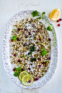 Sprouted Mung and Pomegranate Salad with grated coconut and Pink salt
