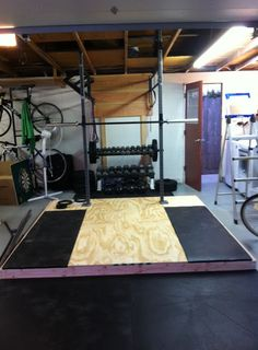 This application solves a couple of problems that the owner of a home gym faces. First, it is not always practical to drill holes in your garage floor, especially if you are renting. The fact that the platform weighs about … Continue reading → Crossfit Garage Gym, Home Gym Garage, Diy Home Gym, Crossfit At Home, Gym Rack, Homemade Gym Equipment, Lifting Platform, Backyard Gym, Home Gym Design