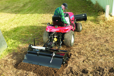 Acheive smoother landscaping with ground engaging lawn tractor attachments.