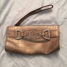 Guess wristlet Snake-like pattern. Wristlet. Barely used. Inside has a few marks but outside is clean. Guess Bags Clutches & Wristlets