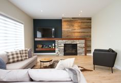 Feature wall with wood planking and stone fireplace. Modern Country, Rustic Modern, Country Style, Living Area, Living Room, Planking, Basement Makeover, Fireplace Ideas, Fireplaces
