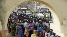 People displaced following attacks by Islamist militants lineup for accreditation before casting their votes, in Yola, Nigeria, Saturday March 28, 2015. 41 known dead so far - all to stop people from voting.