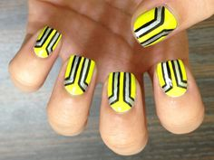 Bold graphic neon nails.