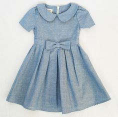 Oliver + S Fairy Tale Dress with pleated skirt and medium sized bow in front. Could use Turquoise Dot Aqua Chambray from the Lisette Collection for a very similar look.
