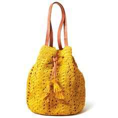 SANIBEL: 100% Crocheted raffia, leather handles, cotton lining, inside pocket and drawstring closure.
