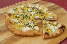 Corn pizza with evoo, roasted corn, zucchini carpaccio, goat cheese, pecorino, honey, mint, balsamic, and Serrano peppers