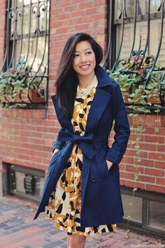 Love this girls style! Bold printed dress with navy trench - feels like fall. Via Extra Petite
