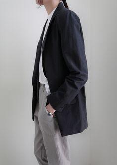 white button down, black blazer, grey trousers, silver watch