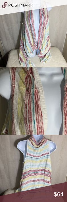 Kenzie Sleeveless Cardigan Size XS/S Shawl collar  Uneven hem but a longer cardigan Red, blues and yellow on a white base. Longer on sides NWT  See materials and care on pictures. See measurements on pictures. Kensie Sweaters Cardigans