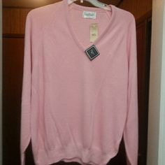 Christian Dior Sweater NWT light pink sweater still with original tags on. Dior Sweaters V-Necks
