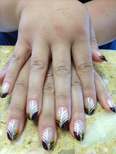 Solar nails with Brown tips with white, gold & silver design