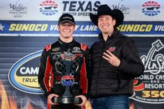 Team owner Kyle Busch and Erik Jones, driver of the #4 Toyota, celebrates in victory lane after winning during the NASCAR Camping World Truck Series WinStar World Casino 350 at Texas Motor Speedway on November 6, 2015 in Fort Worth, Texas. - NASCAR Camping World Truck Series WinStar World Casino 350