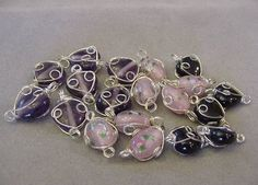 Destash Beads 19 Wire wrapped beads Charms 7 amethyst 5 black 7 pink Jewelry Making Charm Supplies Vintage Wire Wrapped glass Bead destash by Magicclosetbling on Etsy