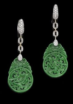 A pair of jade and diamond pendent earrings Each carved openwork jade plaque, suspended from a brilliant-cut diamond line surmount, diamonds approx. 0.35ct total, jade untested, length 6.1cm