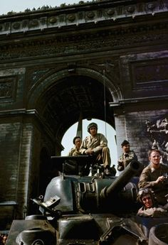 Tanks under the Arc de Triomphe in Paris during liberation celebrations, August 1944.