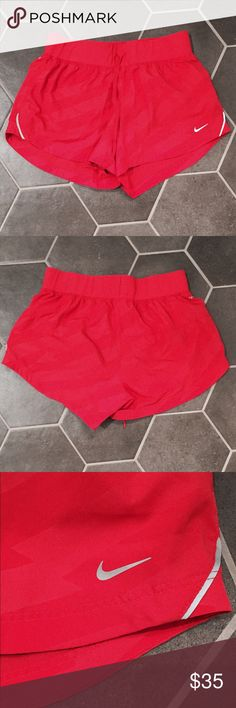 Nike pink running shorts size S Large striped-like pattern that is hard to see. Built in underwear. Great condition. Nike Shorts