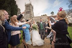 Bride and groom are showered with confetti outside St Andrews church Lulworth, Dorset Wedding Car, Wedding Venues, Wedding Photos, Emerald Green Bridesmaid Dresses, Lulworth Cove, White Wedding Bouquets, Wedding Breakfast, St Andrews, Wedding Confetti