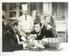 Archie, Wolfe, and Frick in the kitchen