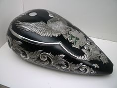 Chased or embossed tank by Alan Jones, Decorative Metal. Amazing work.