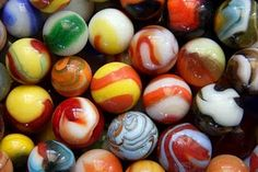 Marbles played on the sidewalk