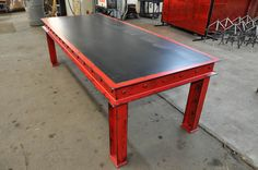 Base price includes a 96 x 40 steel top.  Available in just about any size or finish...  Shown with an aged red finish, and a reclaimed boxcar oak top.  Optional tops: walnut, worn oak, mahogany, cherry