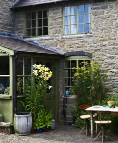English Farmhouse - love the lilies by the door, would smell so wonderful going by!
